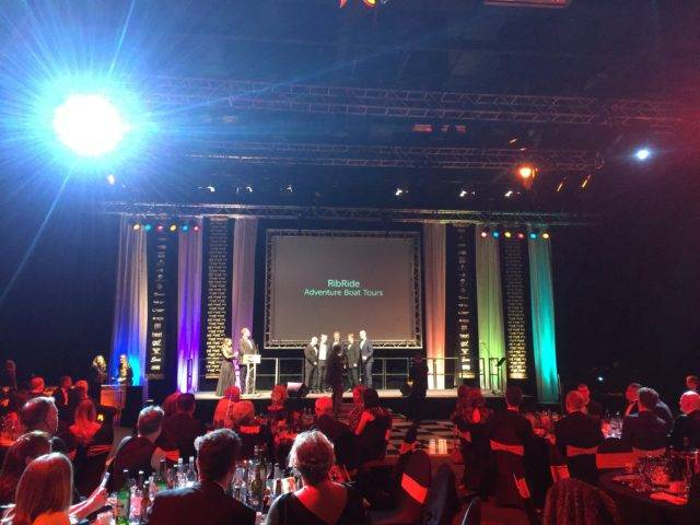 Tom Ashwell and Phil Scott receiving the award on behalf of the RibRide team.